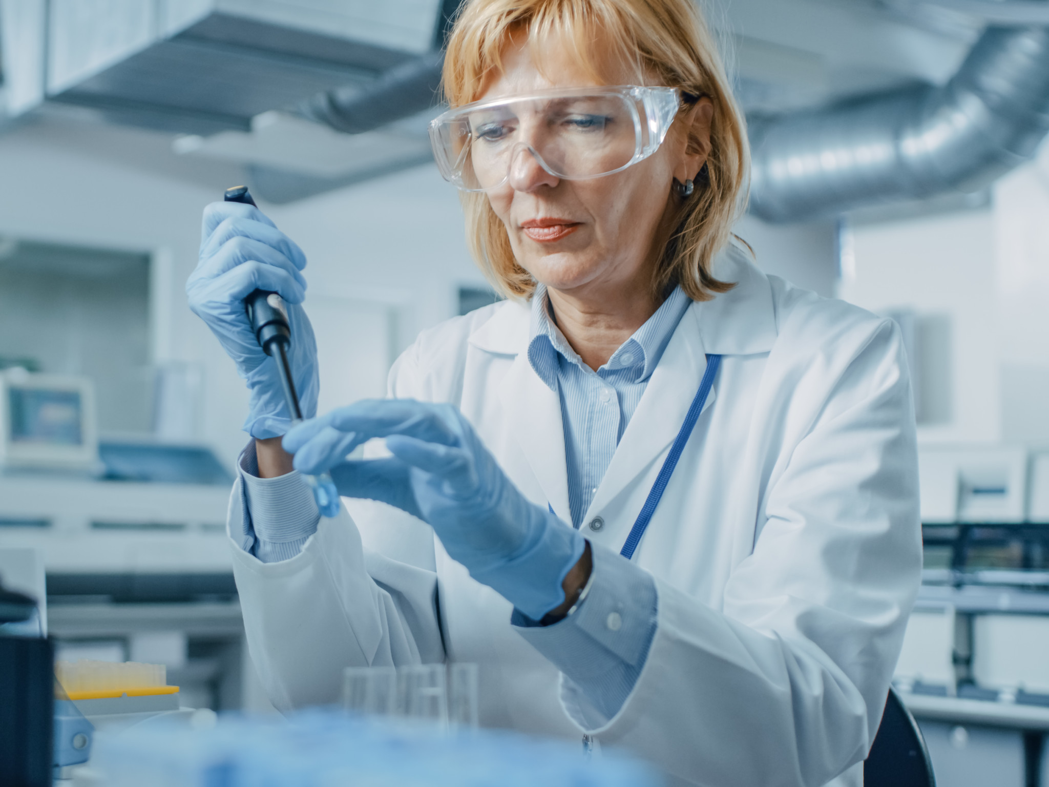 female research scientist taking sample